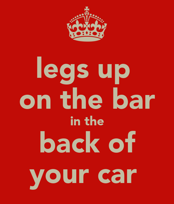 legs up  on the bar in the back of your car