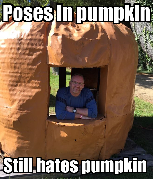 Poses in pumpkin Still hates pumpkin