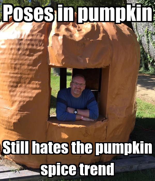 Poses in pumpkin Still hates the pumpkin spice trend