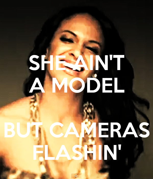 SHE AIN'T A MODEL  BUT CAMERAS FLASHIN'